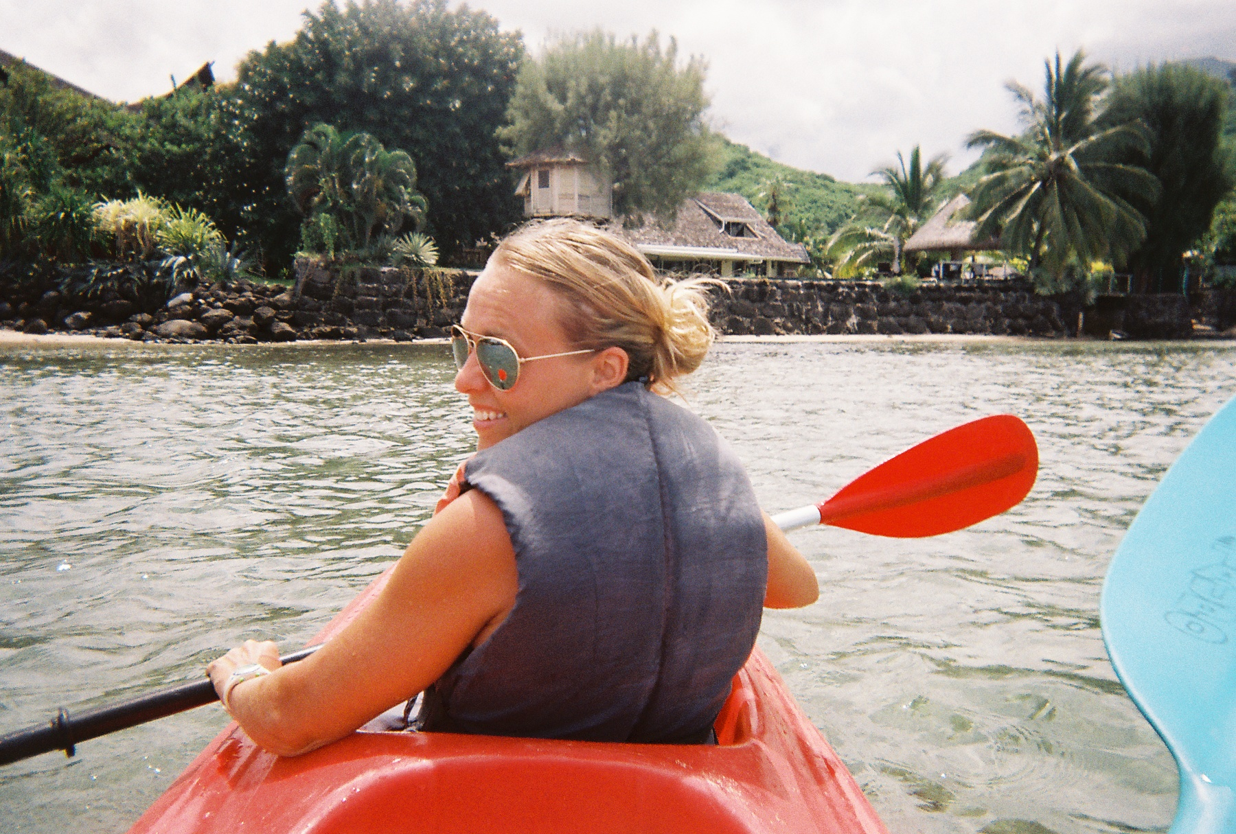 Navigating around bungalows, coral, and multi-colored fish