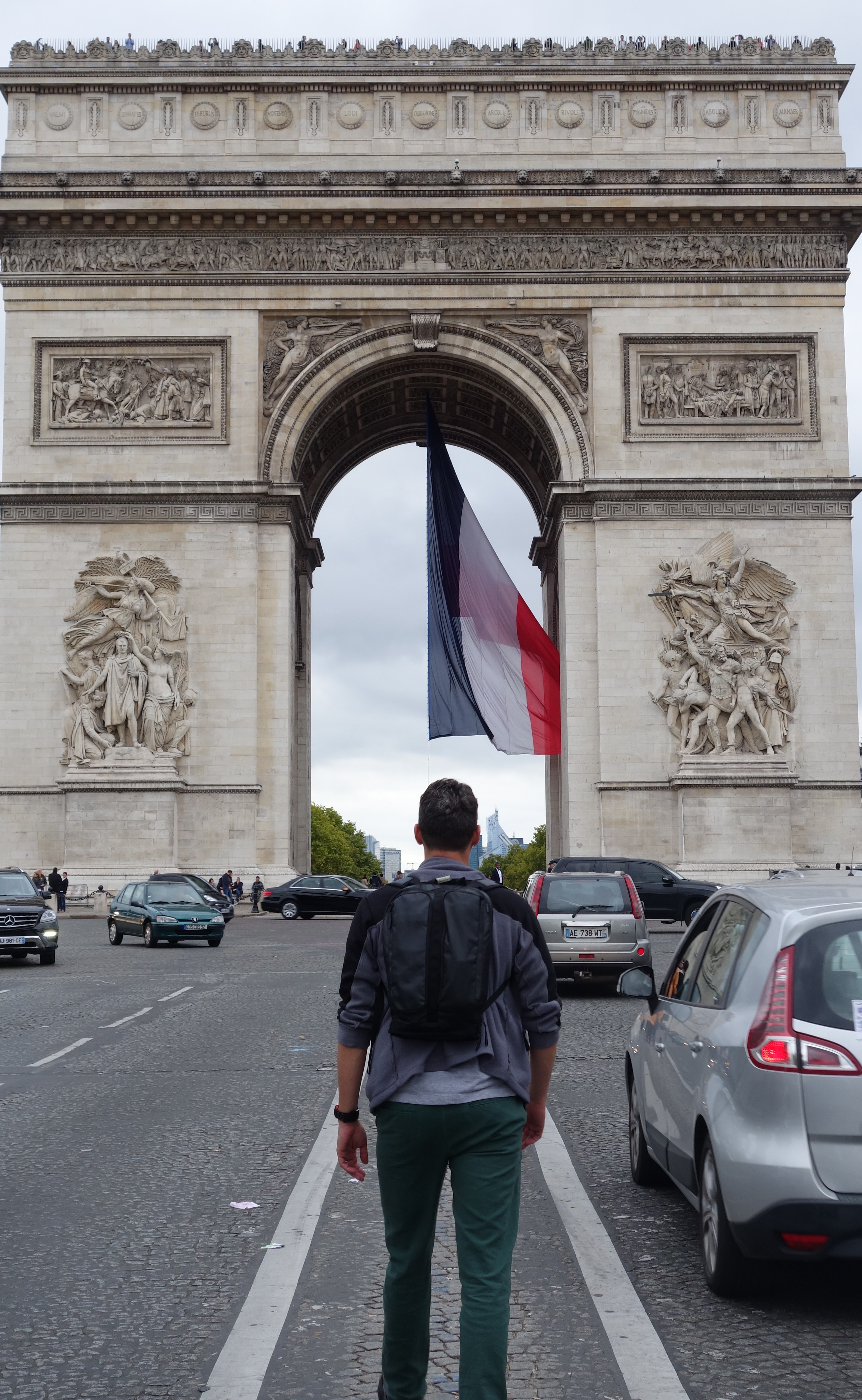 Braving the traffic-heavy Champs-Elysees, in front of the majestic Arc de Triomphe.