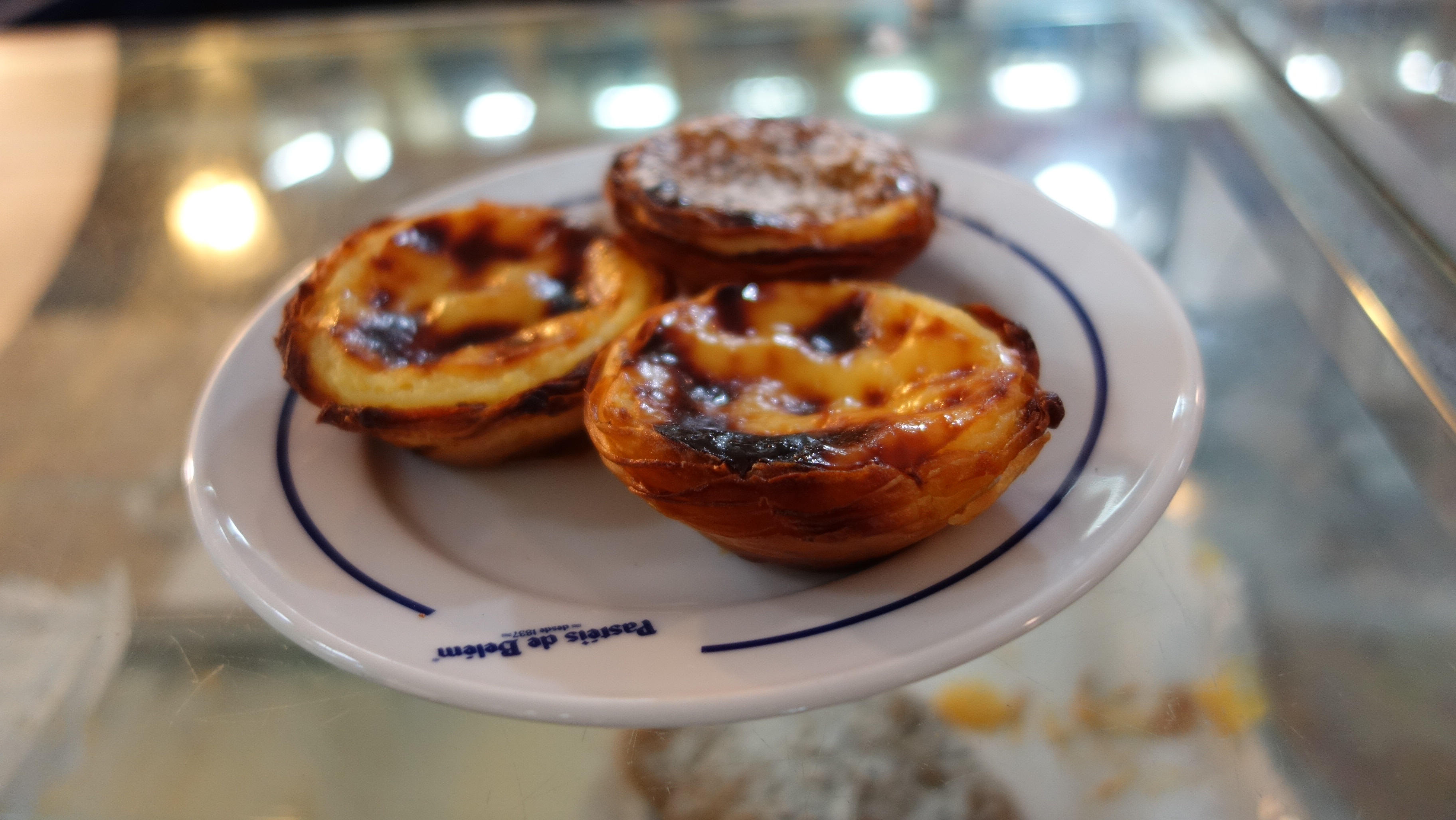 Pastel de Belem is a tasty treat from Pastels de Belem, a pastry shop by Hieronymites monastery. Pastel de nata is a Portuguese egg tart pastry