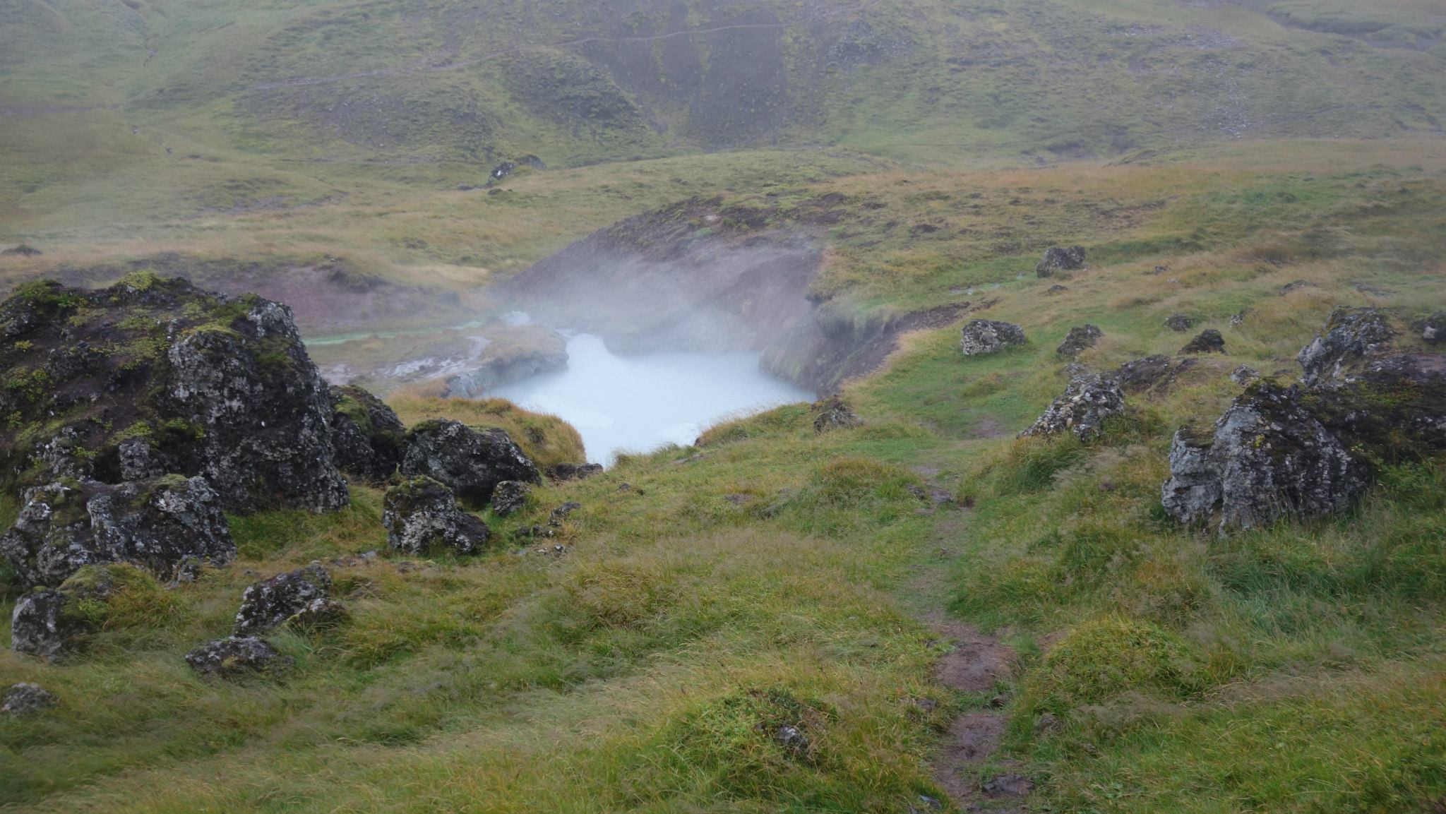 """Reykjadalur Hike, located roughly 35 miles from Reykjavik, the area of Reykjadalur (meaning """"hot river"""") ."""